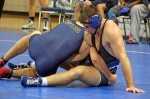 Men's wrestling moves into consolation semifinals