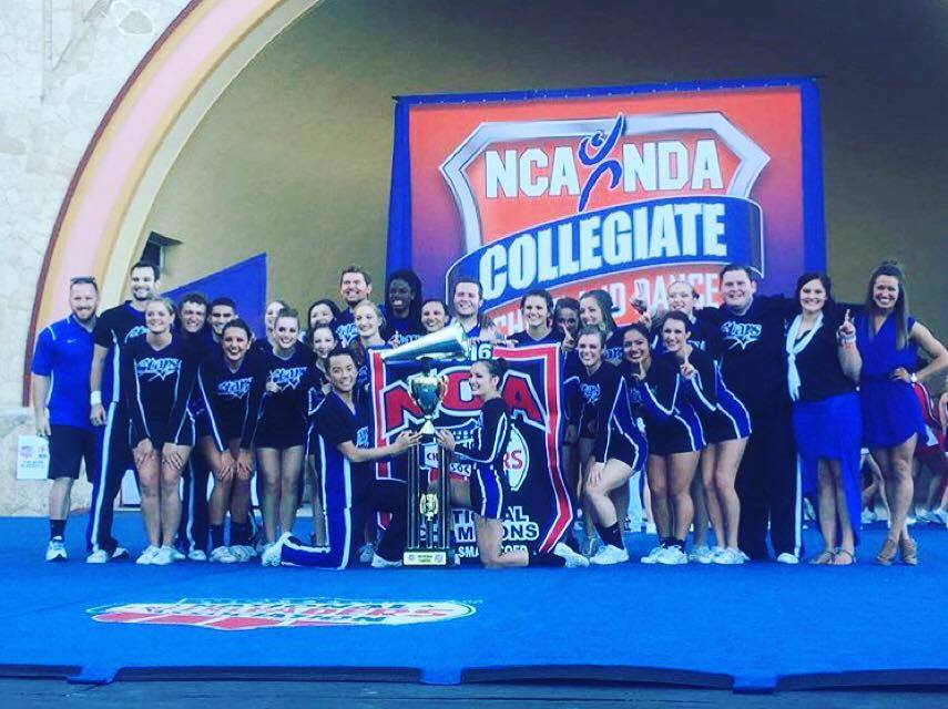 The small co-ed cheer squad poses with its trophy and banners after winning its third consecutive National Cheer Alliance national title in Daytona. Photo: Submitted